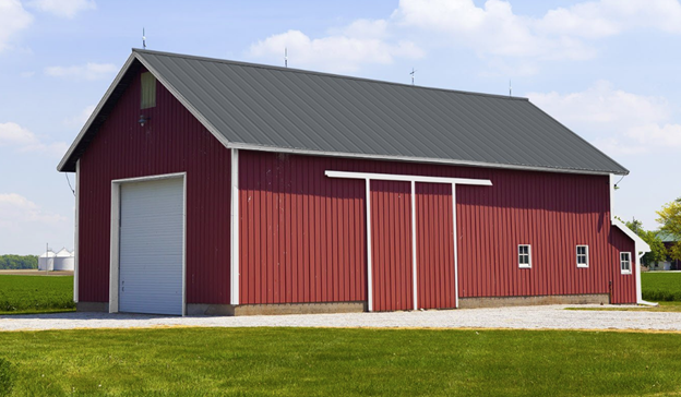 Gray metal roof on a red barn
